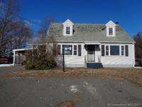 So much to offer in this cape cod style home. Attached