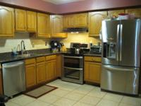 Spacious 3 bedroom end unit. Kitchen is open to large