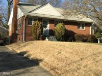 Solid brick home on a nice tree lined street inside the