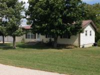 Very nice home with screened in porch and attached