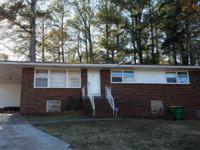 Three bedroom and 1 1/2 bath brick, four side brick