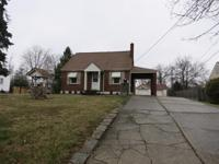 Nice brick home on almost an acre wooded lot. Bonus