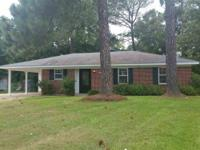 Beautiful renovated brick 3 bedroom home nestled in the