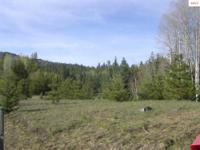 Enjoy country living on four cleared acres, partially