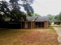 Come take a look at this well built brick home in the