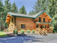 This is a TRUE LOG HOME! 5 acres surrounds this