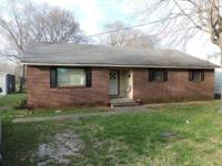 Mostly brick 3 bedroom, 1.5 bath home with two living