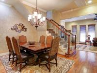 This Tuscan style home in this gated community has much