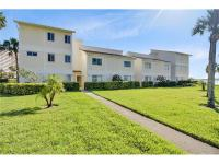 Rare find on Sand Key, this beautiful end-unit 3 bed 2