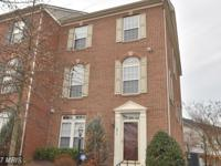 Gorgeous, three level, brick, end townhome in gated