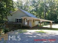 Custom built 3/2 with privacy plus on lovely wooded 6.5