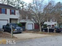 Large townhome located in established community.