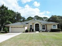 Executive Style Home In Rainbow Woods 1/2 Acre Of