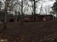 This large 3BR/2.5BA home sits on 1.5 acres and is just