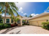 Custom home located in the exclusive gated community of