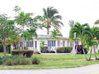 Located In The Exclusive And Gated Island Community Of