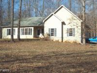 Enjoy Country Charm in this rambler on 2.6 acres.