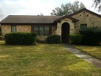 3 bedroom brick house with 3 bedrooms and 2 full baths.