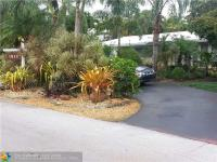 Tropical gardens frame this lovely waterfront 3/2 pool
