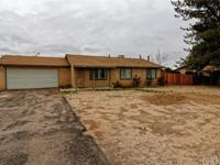 This home is adorable!! Sits on a half acre lot with