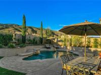 Welcome to this Exquisite Estate Pool Home located in