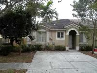 This lovely 3/2 one story townhouse is located at Mowry