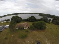 Incredible lakefront opportunity! 3/2 home on Lake