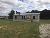 Like New! 3 Bedroom 2 bathroom Manufactured home on 1