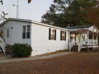 Move to the country! Quiet 3BR, 2BA home on 1.23 acres.