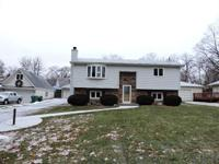 Raised ranch offers 2 levels of finished living space,