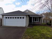 Well maintained single level home with private backyard