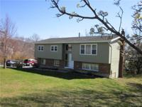 Recently renovated sun filled spacious raised ranch