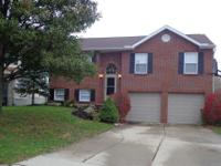 Move-in ready. New carpet, newer roof. Spacious brick