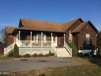 Cedar siding ranch on an acre of flat land. 3 bedroom/2