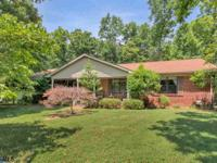 This Corner home on almost two level acres is ready for