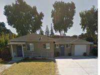 Original house configuration was 3/2. Lovely hardwood