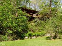 This 3 bedroom, 2 bath fishing cabin sits on 3.39 acres