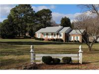 This stately ranch home enjoys an excellent location