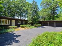Ranch home surrounded by mature Oak Trees. Desirable