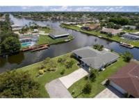 Over 200 ft of waterfront on desirable gulf access san