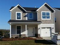 Greenville plan by Windsor Homes. Great front porch!