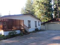 Affordable Sequim home on 2 lots totaling 12,451 sq ft.