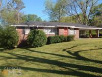 This 4 sided brick traditional ranch is well built and
