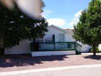 Home is a double wide on leased lot #48 in north point