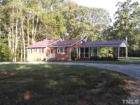Cozy Brick Ranch on 2.95 acres! Updates include New