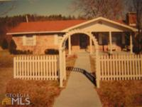 One level ranch traditional 4 sided brick home, with