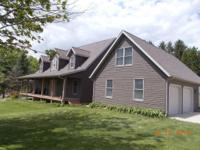 This is a striking country home on 10 acres with 2 big