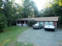 Roomy three bedroom ranch featuring two full baths,
