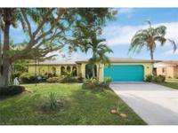 Tropical retreat in the heart of SE Cape Coral! This
