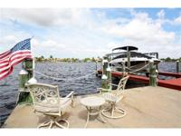 Located directly on Thunderbird Lake in the highly